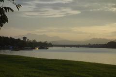 Perfume River, Hue, view to mountains at dusk (judithbluepool) Tags: sunset sky mountains vietnam hue perfumeriver tourboats