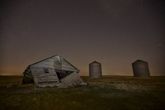 Structures and shooting star (John Andersen (JPAndersen images)) Tags: red green abandoned night barn stars purple farm satellite silo aurora meteor cassiopeia march19aurora