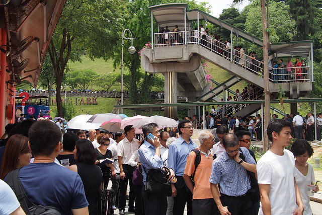 long snaking queues to pay last respects to Lee Kuan Yew lying in state at Parliament House