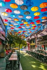 Umbrellas, Antalya, Turkey (Andrey Gavrish) Tags: street city blue sky tree colors turkey chairs turkiye yellowcab antalya tables umbrellas turchia 2014 turkei reastaurant
