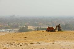 Standing Over Giza (Sound Quality) Tags: africa people animals yellow canon landscape town sand cityscape desert northafrica egypt unesco explore cairo camel egyptian giza worldheritage canon50d spirit7628yahoocom httpwwwtumblrcomblogsoundquality httpwwwflickrcomphotosmichaelwashingtonphotography
