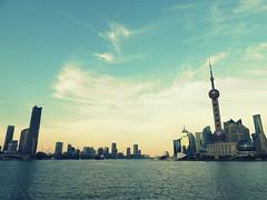 Shanghai skyline by Huangpo river (Germn Vogel) Tags: china travel sky urban cloud tourism skyline modern river asia cityscape waterfront shanghai outdoor shoreline landmark pudong urbanlandscape modernity orientalpearltower eastasia huangpo