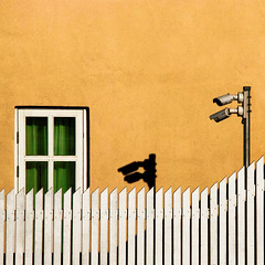 Cabin fever (Arni J.M.) Tags: windows orange white building green wall architecture fence iceland shadows curtain cctv reykjavik diagonal cabinfever ísland
