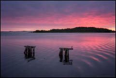Solnedgang (Jonas Thomn) Tags: sunset sea water clouds island evening waves purple jetty lila pillars vatten hav solnedgng brygga moln vgor  kvll pelare