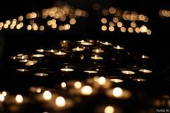 Candle Lights at Notre-Dame de Paris (Nabila M.) Tags: paris france dark lights candle cathedral bokeh prayer notredame canoneos cathedrale mycity amateurphotographer frenchphotographer canon1200d