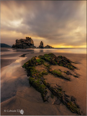 El playn (Caramad) Tags: longexposure light sunset sea espaa seascape color sol marina landscape mar agua rocks asturias playa puestadesol olas rocas marcantbrico camadats