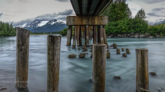 Pilings from the past (Traylor Photography) Tags: longexposure trestle bridge mountains water flow pilings portageglacier current sewardhighway alaskarailroad glacial portagecreekno2