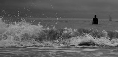 Behind me the surf. Ahead of me, the cold grey (xhupf) Tags: ocean bw liverpool surf waves shoreline crosby anotherplace burbobank