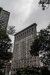 Flat Iron Building (Tamara Dobry) Tags: new york nyc city buildings empire state building manhattan met life people journalism black white flat iron chaos panning motion blur cars business taxis grand central station clouds fashion travel photography sigma lens nikon d610 full frame tamara dobry red mill village clinton jersey high views