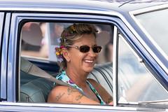 Drivers - Flowers in her hair - Jacaranda Parade 2015 (sbyrnedotcom) Tags: 2015 people events grafton jacaranda parade rural town woman driver flowers hair tattoos smiling nsw australia