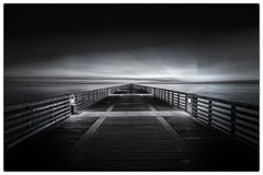 Alone On The Pier (shutterclick3x) Tags: longexposure blackandwhite bw sunrise dawn pier lightandshadow frankloose
