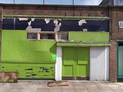 2nd April 2015 (themostinept) Tags: blue sky white green wall paint pavement brickwall peelingpaint stevenage hertfordshire doorways