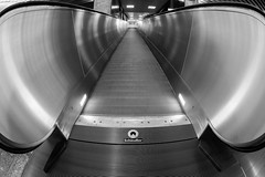 Schindler (Daniel Kulinski) Tags: city railroad urban bw white black station night photography town europe track image daniel main escalator transport central wide creative picture fast samsung poland rail fisheye communication capitol list warsaw civic 1977 warszawa photograhy schindler 10mm nx mazowieckie nx1 kulinski samsungnx samsungimaging danielkulinski samsungnx10mmf35 samsungnx1 samsung10mm samsung10mmf35 nx10mm