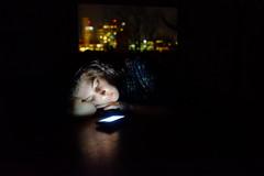 (Sasha Patkin) Tags: city light urban window girl modern dark lights fuji technology phone magic dreaming fujifilm lit spirituality spiritual lostinthought iphone modernity vsco vscocam x100s
