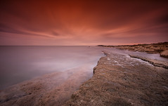 Red on the rocks! (Explored) (Dave Holder) Tags: longexposure red sea sky orange water sunrise waterblur northyorkshire filey eastyorkshire flamborough canonefs1022mm kood fileybrigg nd10 bigstopper canon70d