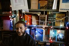 (Nowhere land ) Tags: portrait man smile lights luces colours retrato library books bookshelf colores biblioteca sonrisa libros hombre clubatlticodepoetas