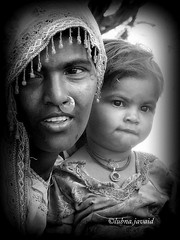 Every experience makes you grow (LubnaJavaid) Tags: pakistan woman white black smile face women child faces n sindh