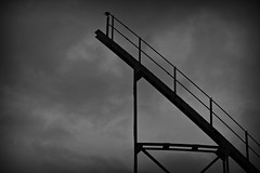 Reach for the sky (Steve.T.) Tags: sky blackandwhite lines clouds mono moody angle steps angles structure gasometer gasholder