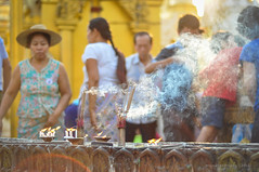 Shwedagon Pagoda Incense (Nicholas Olesen Photography) Tags: city travel sunset people tourism horizontal outdoors pagoda nikon asia afternoon shwedagon yangon burma smoke capital religion praying belief myanmar southeast incense rangoon d90