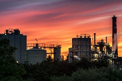 Don't panic! It's only the sky that's on fire (marielledevalk) Tags: sunset sky cloud building skyline architecture industrial factory outdoor smoke