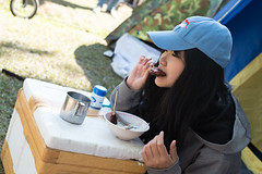 Prachinburi-Thailand 31Dec-2014:Unidentified girl enjoy eating pork grill in morning at camping (leykladay) Tags: activity breakfast burn camping cancer delicious eat female food girl grass grilled ground holiday hungry mat mountain pork relax rice stove stricky