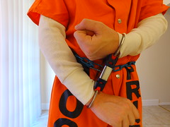 Orange Jumpsuit (boblaly) Tags: orange prison prisoner jail inmate handcuffs cuffed shackled shackles chains chained restraints detention convict arrested belly chain jumpsuit uniform