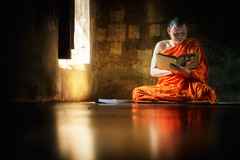 Monk reading book (santifoto9) Tags: poverty school light boy red portrait people man green smile face yellow kids rural asian thailand religious temple person reading book student education asia adult little robe buddha buddhist traditional small religion young culture belief buddhism indoor study monastery monks thai learning teaching tradition ethnic eastern sanctuary cultural bagan ayutthaya novice