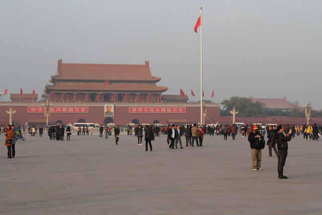 Haze fills the air at Tiananmen Square as the sun starts to set