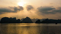 A Sea of Towering Limestone (departing(YYZ)) Tags: ocean sunset sea mountains water silhouette clouds bay boat asia southeastasia peace calm vietnam viet unescoworldheritage halong nam halongbay limestonekarsts