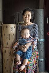 Sari and ZhongDa (Budiman Lays) Tags: portrait hug son sari carry rumah