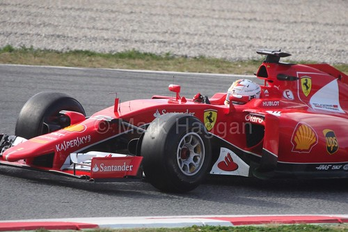 Sebastian Vettel in his Ferrari at Formula One Winter Testing 2015