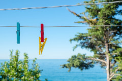 Summer colours (denyB) Tags: blue red sea summer sky sun hot verde yellow photography hug fujifilm clothespins xe2