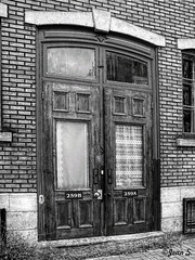 259 (Jean S..) Tags: blackandwhite bw brick window monochrome doors outdoor sidewalk appartment buiding