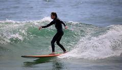 A surfer rides a wave off Manasquan Beach. (apardavila) Tags: surf waves surfer surfing jerseyshore atlanticocean manasquan manasquanbeach