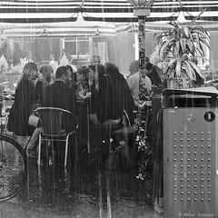 Downpour (Akbar Simonse) Tags: people bw holland blancoynegro netherlands monochrome rain zwartwit candid nederland streetphotography denhaag bn parasol squareformat haag thehague afvalbak regen downpour cloudburst garbagebin vierkant wolkbreuk lahaye sgravenhage stortbui agga straatfotografie dscn2603 akbarsimonse