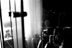 Doll behind glass (Nikon FM3A) (stefankamert) Tags: stefankamert doll glass nikon fm3a fm bw sw baw blackandwhite blackwhite schwarzweis noir noiretblanc ilford voigtlnder ultron film analog grain reflection