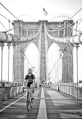 Crossing the bridge, New York (belthelem) Tags: travel bridge usa newyork black byn brooklyn walking 50mm drive nikon manhattan running tourist brooklynbridge ciclista bycicle nuevayork d700