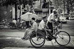 Sai kaa rickshaw in Yangon, Myanmar (AmanSingh_) Tags: travel blackandwhite monochrome asia asians yangon burma wanderlust backpacking myanmar rickshaw burmese asean streetview rangoon trishaw peopleonthestreets umbrellawoman yangondowntown burmapictures yangonstreets peopleofyangon saikaa rickshawsosmyanmar rickshawsofasoutheastasia transportinsoutheastasia rickshawsofsoutheastasia rickshawsofasia asianricksaws