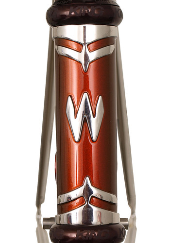<p>Head tube detail of a Waterford 22-Series frame with custom Empire (art deco) lugs, painted Copper Metallic.</p>