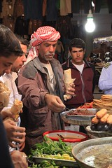 People and Street Food  Aleppo The Ancient City That Was Nov 1 2010 Syria Middle East (eriagn) Tags: travel art history tourism wool rock fruit architecture concrete religious photography wooden traffic citadel minaret traditional prayer religion middleeast streetphotography documentary mosque tourist tourists unescoworldheritagesite traveller textures syria souk historical produce bazaar dailylife textiles fortification moat fortress weaving income citizens aleppo hawkers syrian bathhouse suq shopkeeper marked beliefs ngaire mosqueinterior ancientcity umayyadmosque orientalrugs camelhair medievalbuilding ceilingdecoration oldwalledcity citadelofaleppo traditionaltextiles eriagn ngairehart almadinasouq syrianstreetfood syrianpostbox