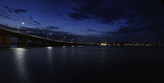 Blue Night (Forster Bridge) 5k Widescreen - DSC02128-29 Pano4 (ps11) (cleansurf2) Tags: ocean street city longexposure bridge blue light sunset sea wallpaper seascape black color colour reflection water architecture night clouds river dark landscape prime bay coast arty view screensaver background widescreen sony north wide smooth vivid surreal australia scene hires negativespace nsw hd bluehour 16mm 5k forster 4k tuncurry highres leadinglines mirrorless minimual a6000 sonyilce6000