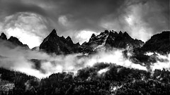Chamonix Mountains B-W (PicOfJo) Tags: sky sun white black mountains alps fog clouds alpes landscape noir nuage paysage et chamonix blanc