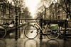 In Amsterdam, more than 60% of trips are made by bicycle per Wikipedia. The most bicycle friendly capital city of the world!! (KayYen) Tags: bridge water netherlands dutch amsterdam bicycle canal wheels rainy cycle friendly jordaan egelantiersgracht