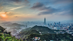Misty Sunset  (Sharleen Chao) Tags: city winter sunset urban color building horizontal skyline clouds skyscraper canon landscape day cityscape outdoor taiwan nopeople 101  taipei nightscene taipei101  dramaticsky tone hdr  partlycloudy highangle 101 capitalcity 1635mm  canoneos5dmarkiii