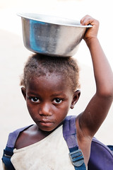 F6257 ~ When children help family to survive... #mundoasorrir (Teresa Teixeira) Tags: guinbissau bissau kid child cashewnut castanhadecaju missingschool mundoasorrir health oralhealth teresateixeira