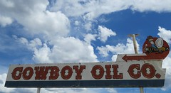 Cowboy Oil Co. (3 of 3) (jimsawthat) Tags: sky urban clouds neon gasstation idaho vacant outofbusiness servicestation pocatello metalsigns vintagesigns