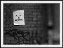 please be awesome (Andrew C Wallace) Tags: blackandwhite bw streetart brick wall lensbaby poster ir collingwood australia olympus victoria infrared tiltshift nikon50mmf14 tilttransformer olympusomdem5 pleasebeawesome