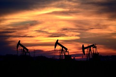 Oil Country Sunset (faithroxy) Tags: alberta oil country blackgold pumpjack silhouette sky outdoors sunset evening summer canada leduc1 discovery crudeoil exploration petroleum economy clouds