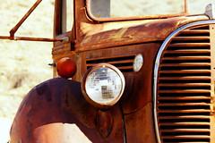 Under a Watchful Eye (nedlugr) Tags: california ca ford truck rust shadows desert grill ghosttown headlight ruraldecay mojavedesert randsburg ruralwest