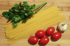 Food composition: spaghetti, tomatoes, garlic and parsley (spk333) Tags: wood italy food white color colour green kitchen colors yellow closeup tomato cuisine wooden leaf healthy italian colorful long mediterranean raw colours close wheat board traditional tomatoes group grain culture objects tasty nobody pasta fresh health ingredients chopping garlic taste colourful diet spaghetti parsley foodstuffs culinary macaroni gastronomy nutrition ingredient spaghettini uncooked backround